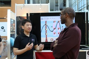 Mike explaining our app to Greg Dismond